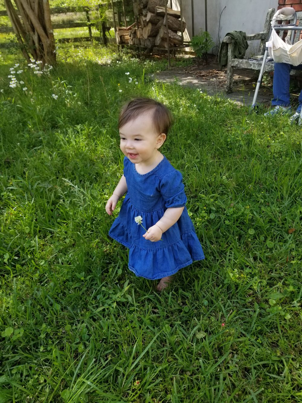 Happy baby on a lawn
