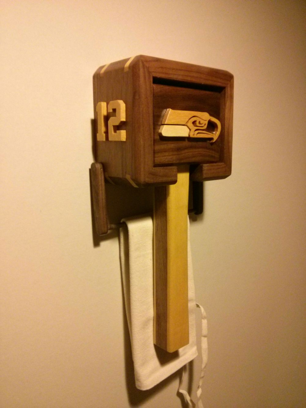 Inlaid wood Seahawks-themed ice hammer