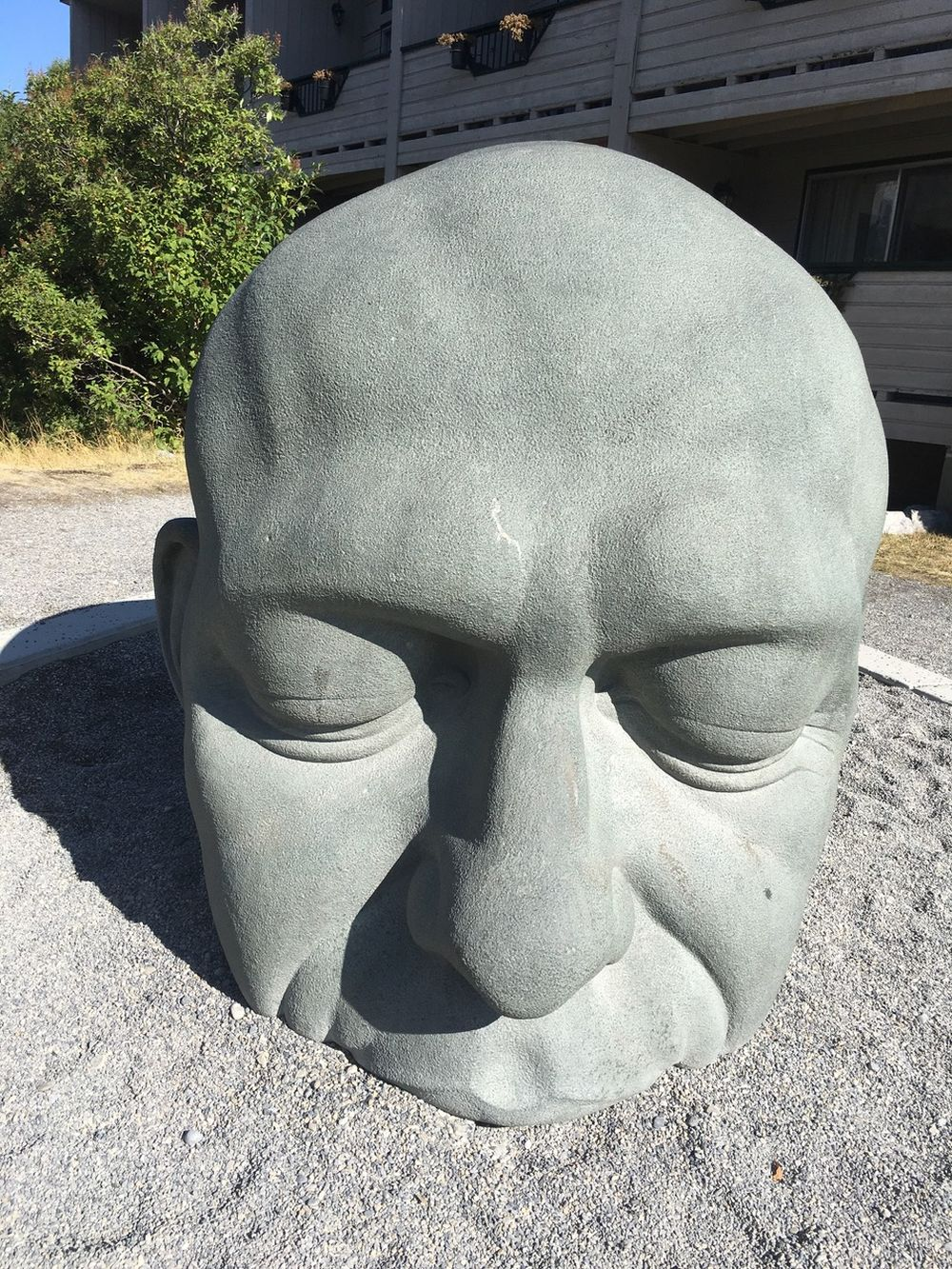 Concrete sculpture of a head